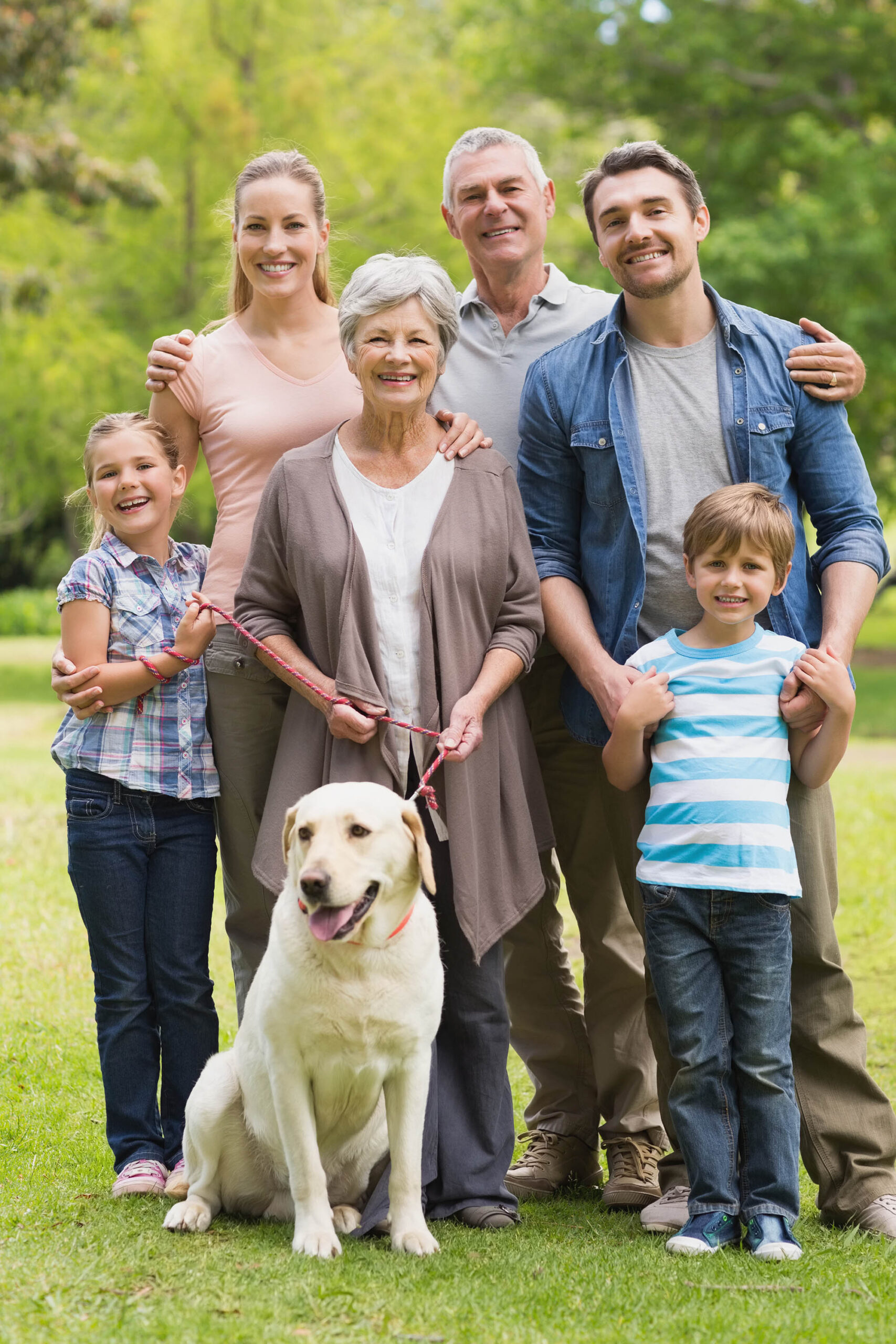 Portrait of an extended family with their pet dog