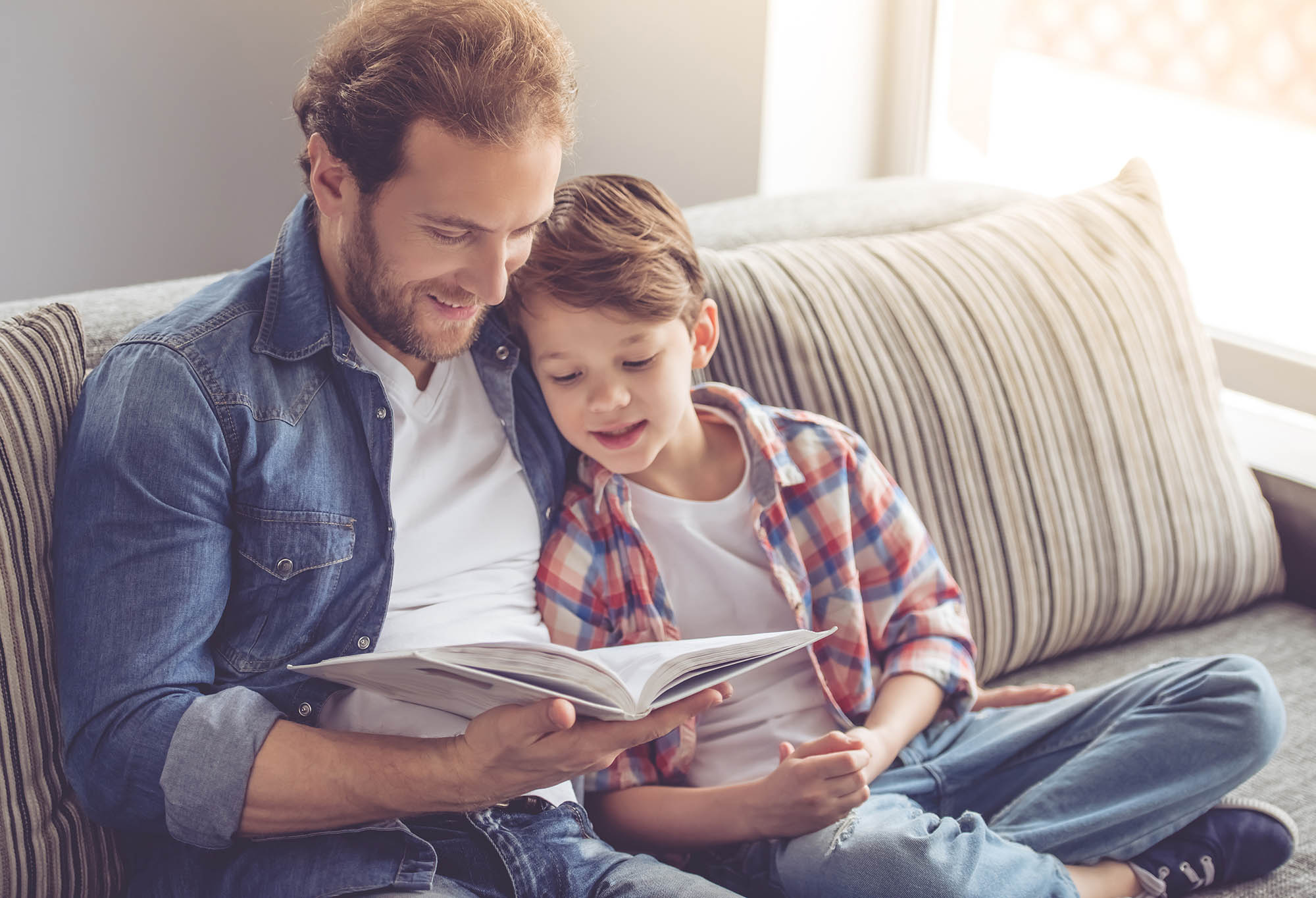 Father and son are reading a book