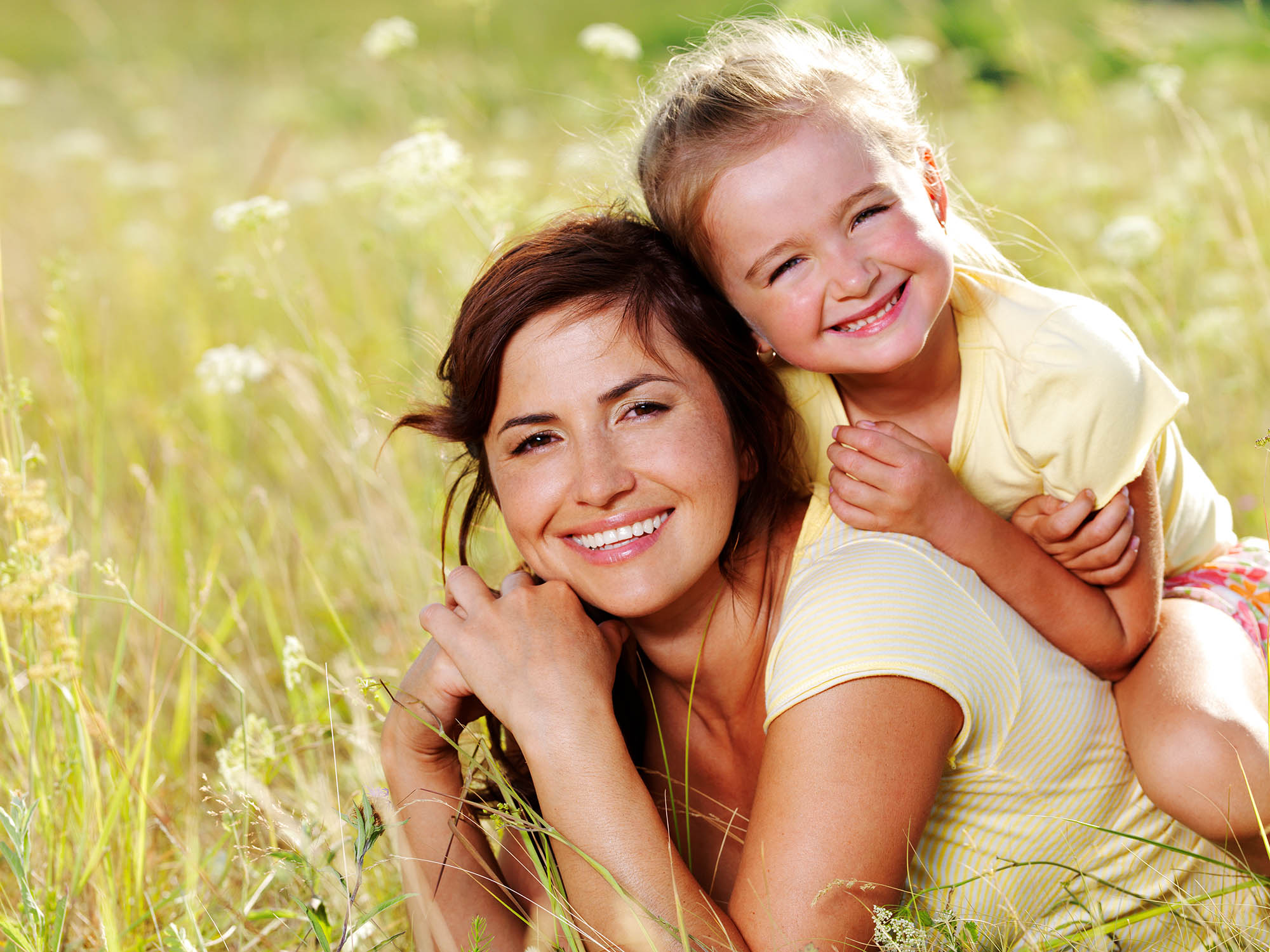 Smiling mother and little daughter